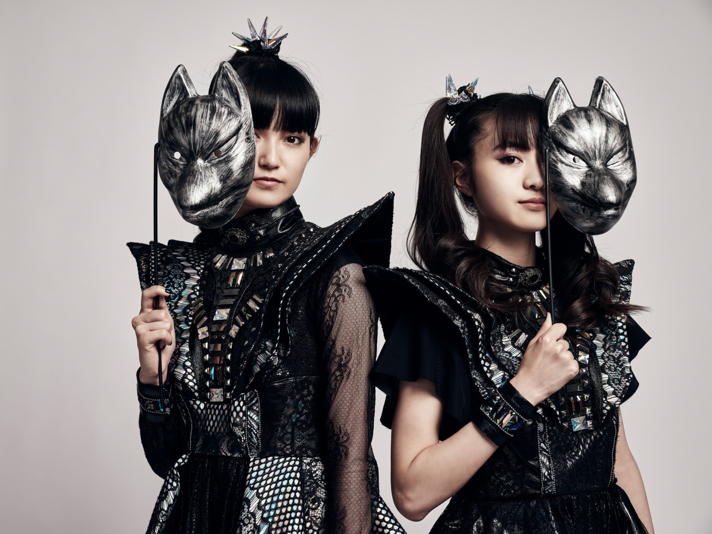 Japanese band Babymetal holding up new fox masks