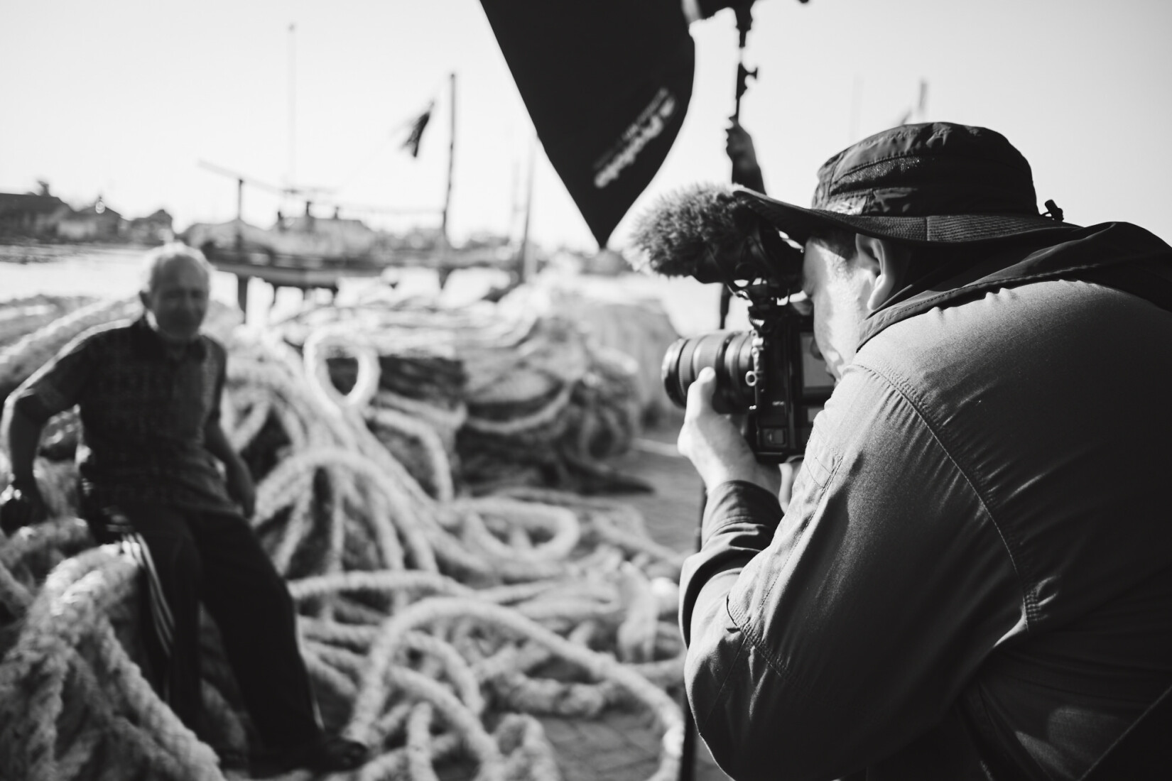Shooting one of the fishermen, Yono in the harbour.