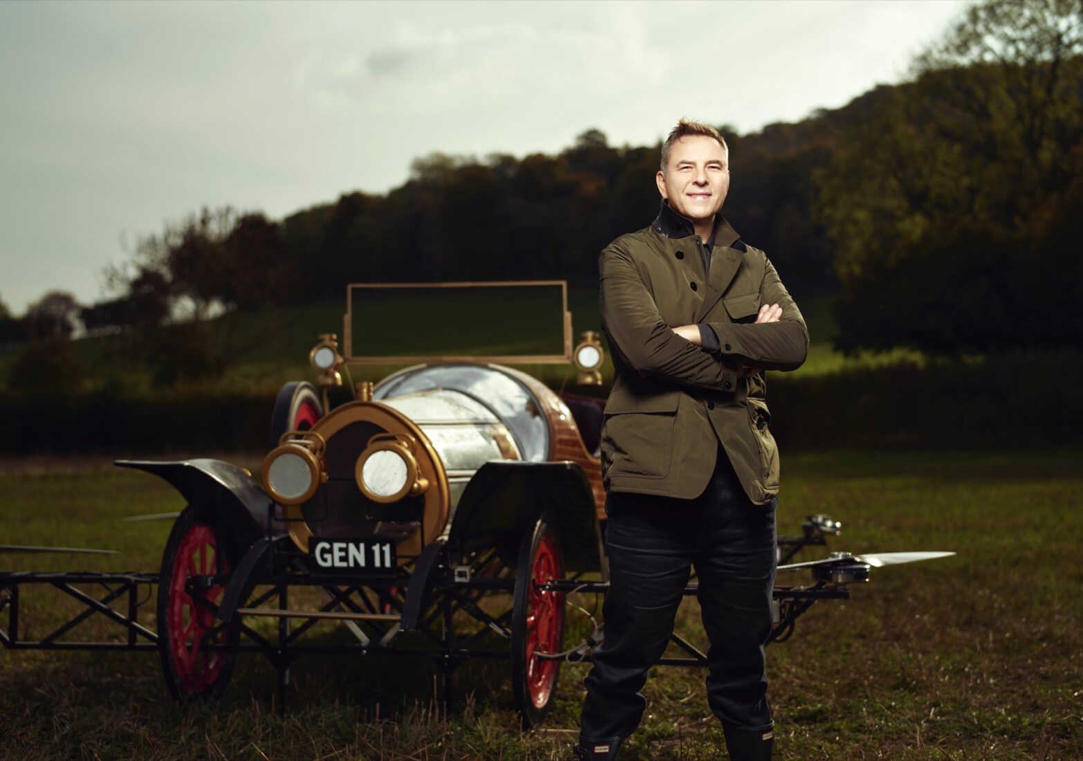 David Walliams stood in front of Chitty Chitty Bang Bang, the flying car.