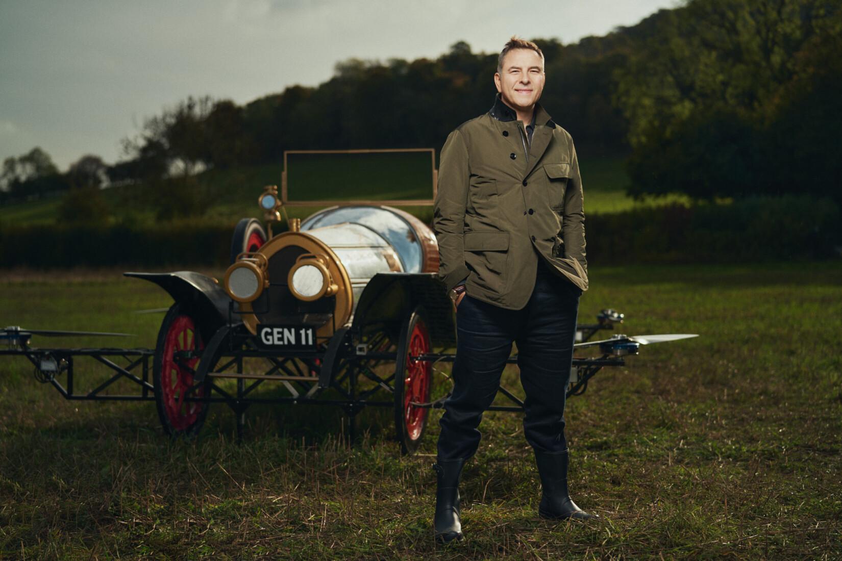 David Walliams stood in front of Chitty Chitty Bang Bang, the flying car.