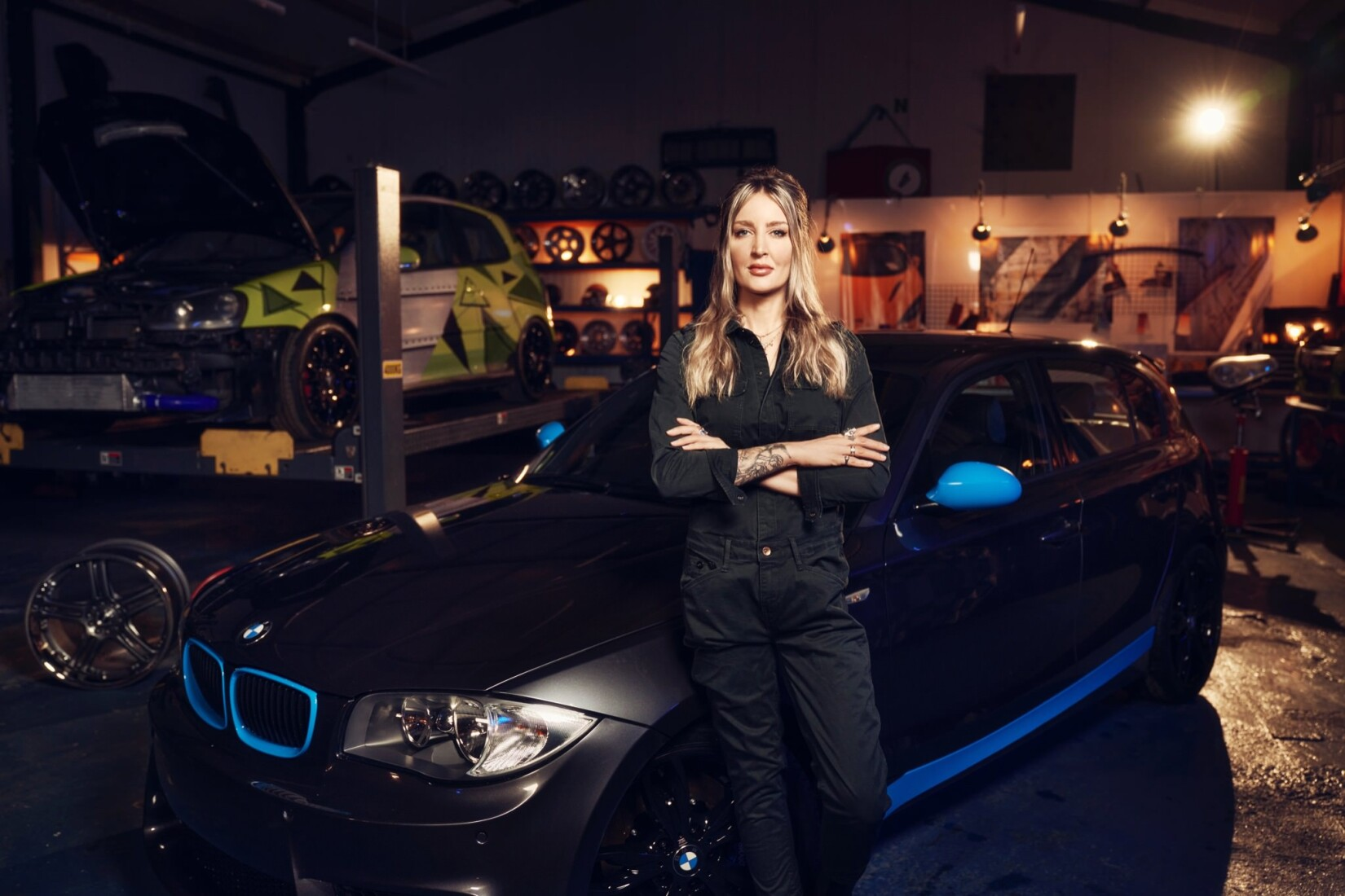 Helen Stanley leans against the BMW 1 Series featured in the series.